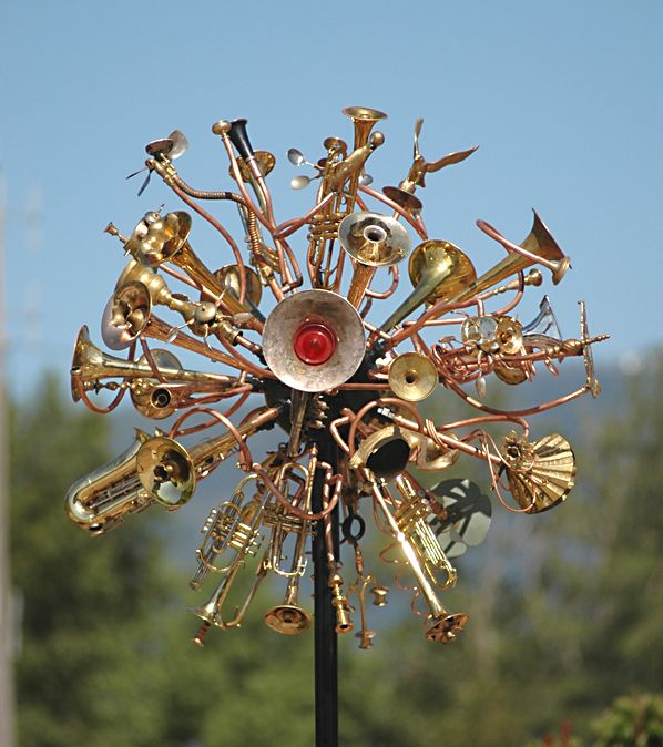 Made from a collection of none ferrous recycled metals including musical instruments fire pokers, chair parts and a 1955 Buik tail light cover this trash art sculptural weather vane stands fourteen feet tall in front of the museum in Castlegar. more information here: http://www.waterworksgardenart.com/