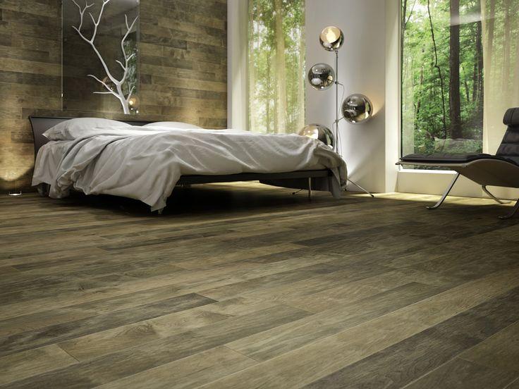 Chambre à coucher ambiance nature, plancher de bois franc et décoration rustique. Rustic bedroom atmosphere.