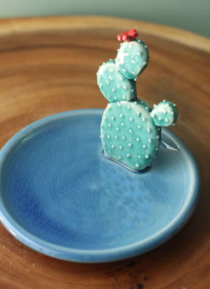 http://sosuperawesome.com/post/160857709212/porcelain-cacti-dishes-and-vases-by-pottery-and