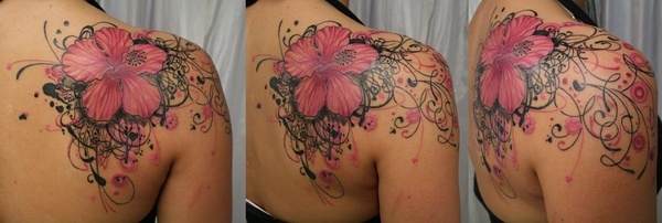 Pink flower tribal tattoo