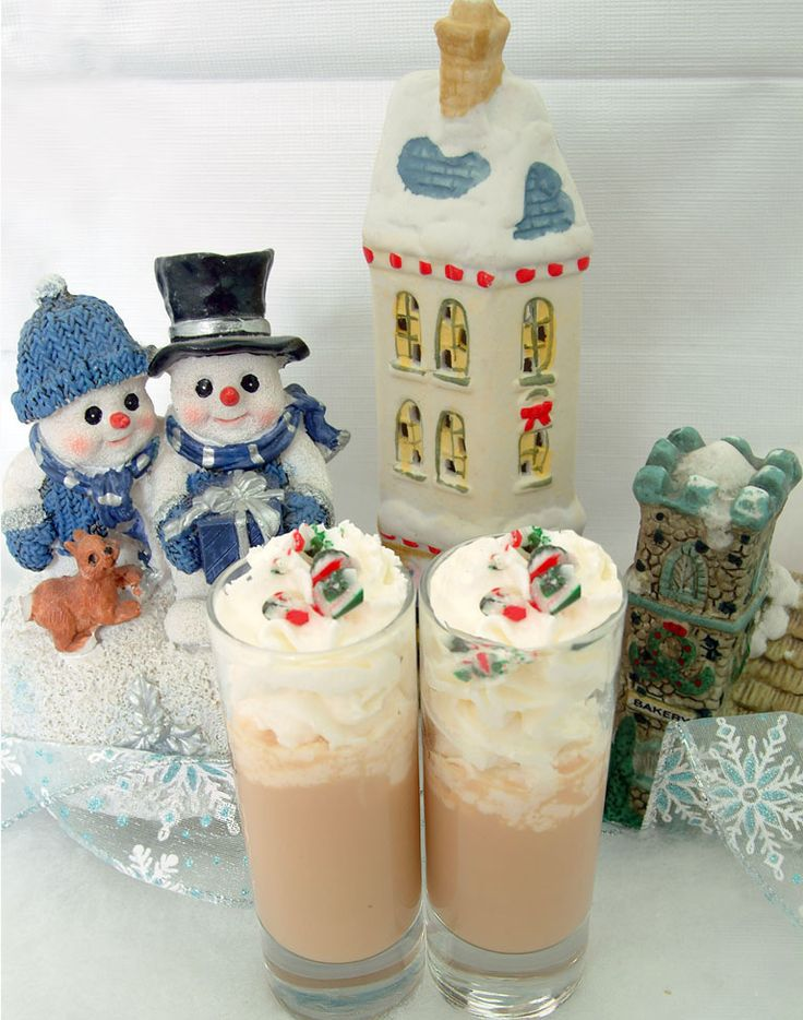 North Pole Kiss:      amaretto - 1 oz      Baileys - 1 oz      whipped cream -      candy cane, crushed - 1    Instructions:    * This recipe makes 2 servings.        Combine the amaretto and Baileys in a shaker over ice.      Pour the mixture into 2 tall shot glasses.      Top off each shot glass with whipped cream.      Sprinkle the top of each drink with crushed candy cane.
