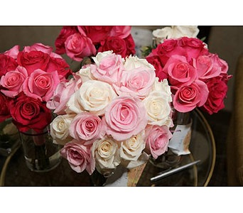 Bridal bouquet of all cream and pink roses and brides maids bouquets of hot pink and deep pink roses.