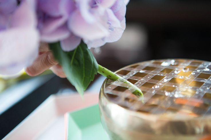 A Florist's Tricks to Arranging Flowers and Keeping Them Alive Longer   Create a grid with transparent tape to keep your flowers in place when using a shallow vase.