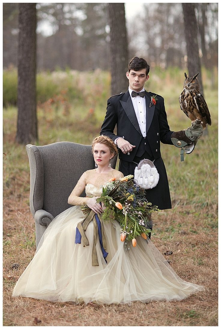 Scottish highlands wedding inspiration. Bride and groom with owl. Bouquet with tulips, pheasant feathers and thistle by Gertie Mae's Floral Studio. Kilt from Atlanta Kilts. Image by Shauna Veasey Photography.