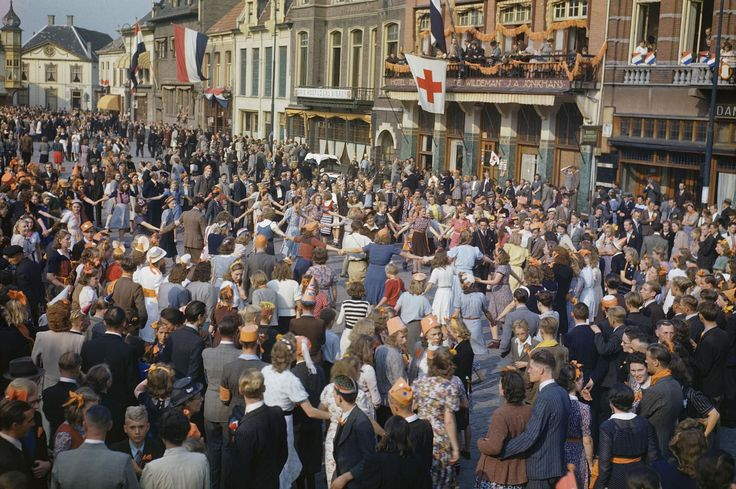 Dutch civilians dancing in the streets after the liberation of Eindhoven by Allied forces, September 1944. But the scenes of celebration during the early stages of the doomed Operation Market Garden in September 1944 proved shortlived. Hours after the pictures were taken, the Germans launched a devastating air attack on Eindhoven, destroying buildings and killing scores of civilians