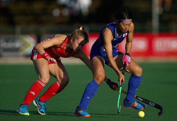 Kana Nomura of Japan and Shona McCallin of England battle for possession during day 3 of the FIH Hockey World League Semi Finals Pool A match between Japan and England at Wits University on July 12, 2017 in Johannesburg, South Africa.