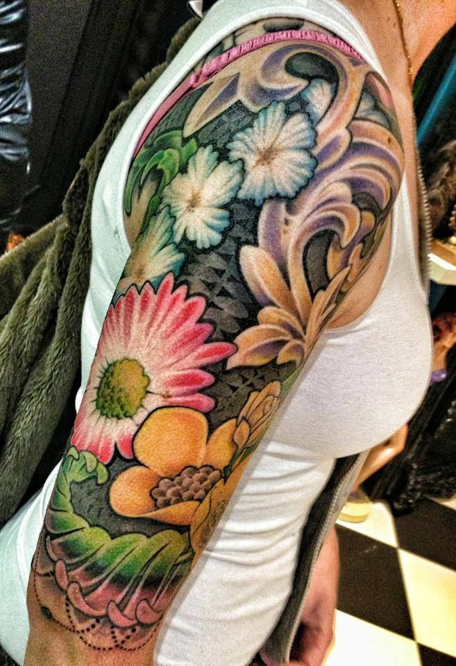 Flower arm tattoo sleeve nice colouring and sculpting for Flower tattoo arm