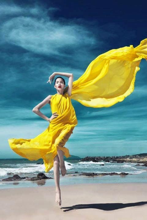♂ Fashion editorials photography woman with bright flowing gown at the beach