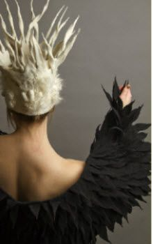 Make a 'feathered' cape from felt. Easy to work with and no moop. Burning Man.