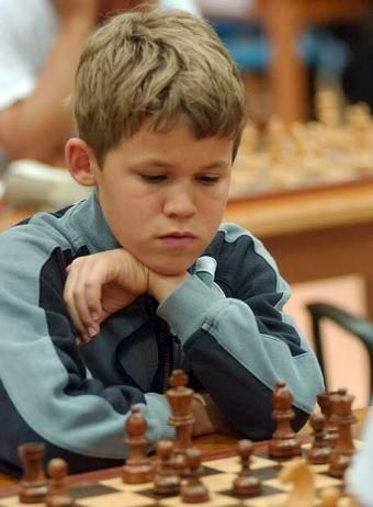 young+magnus+carlsen | Carlsen has black in this game.he is the best chess player in the world when he was7years old