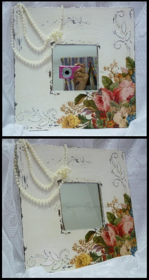 IKEA mirror-IDEA-decoupaged with newsprint or old magazines, then topped with edge of napkins