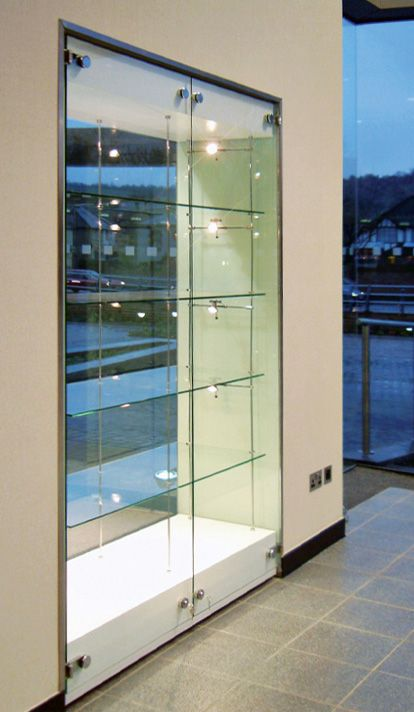 A Built In Display Cabinet Wall With Suspended Shelving