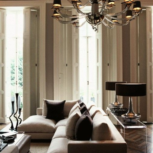 Interior Design * Living with Neutrals, so sleek, modern and beautiful symmetry. Love the oversized classic chandelier with this modern decor.