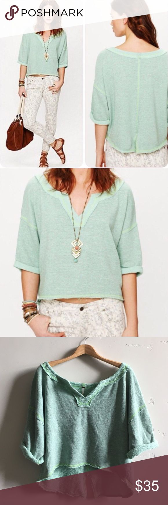 Free People Cropped Teal Sweatshirt Speckled mint green, slouchy and oversized terry top. Dolman cuffed sleeves, split neckline, cropped at waist, raw edges and slit at bottom back.  Preloved.  No rips, tears or stains.  In great, gently used condition. Free People Tops