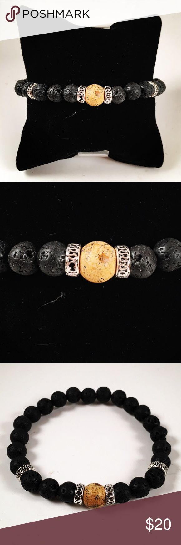 Men beaded bracelet. Lava rock and jasper Men beaded  bracelet. Fits most , 7.5 to 8.5 inch wrist . Handmade by me , never worn by anyone. Made with black lava rocks / volcano beads. Jasper bead and tibetan silver deco charms. I ship fast!! ✈️ Accessories Jewelry