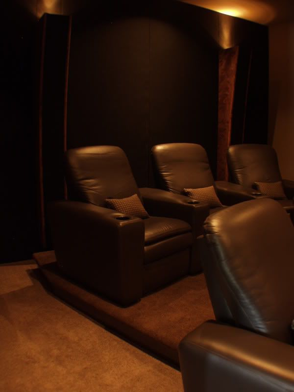 Another home theater DIY idea combining speakers and mood lighting in floor-to-ceiling pillars.