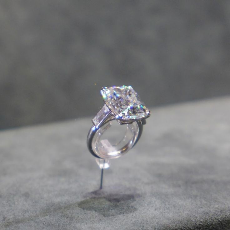 <p>The wedding ring that Prince Rainier gave Grace Kelly was made by Cartier in 1956. The platinum, one emerald-cut diamond weighing 10.47 carats is flanked by two baguette-cut diamonds. Check out more photos of the ring from the Jewellery Editor.</p>