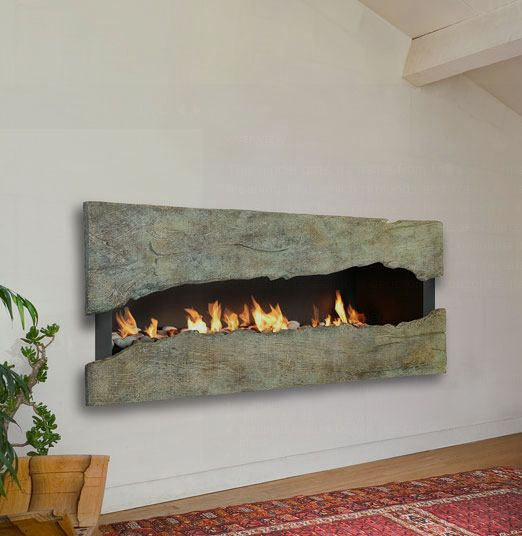 Beautiful design for the fireplace. Sculpted bronze but looks like wood or even stone.