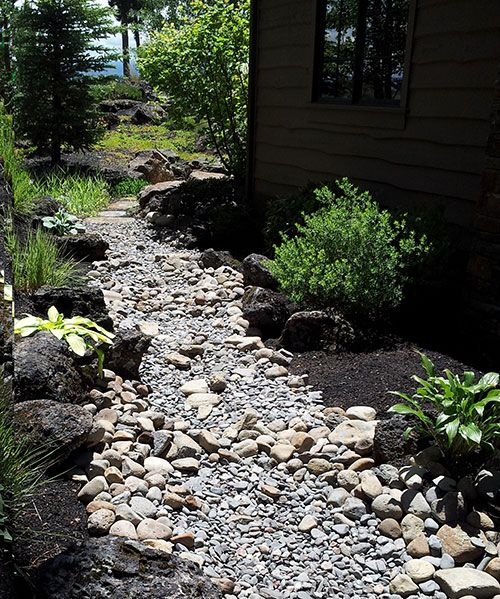 dry creek bed landscaping looks best with multii sized stones and grasses dry creek bed. Black Bedroom Furniture Sets. Home Design Ideas