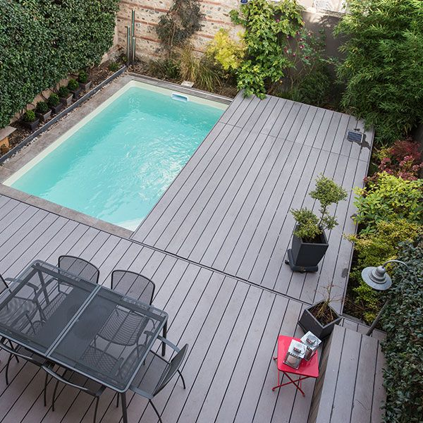 Terrasse coulissante pour piscine swimming pools for Terrasse pour piscine