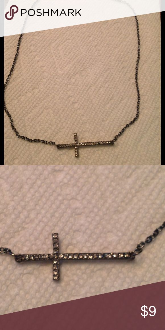 Black rhinestone cross necklace Black rhinestone cross necklace.   Cross is approximately 1 1/2 inch Jewelry Necklaces
