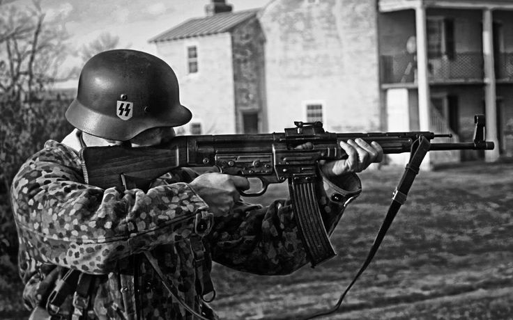 1944, Waffen SS Soldier aiming a Sturmgewehr.
