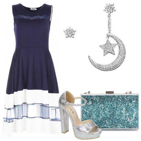 Splendido+abito+blu+scuro+al+ginocchio,+con+gonna+svasata+e+inserti+trasparenti.+Ho+abbinato+sandali+argento,+con+plateau+e+tacco+a+blocco,+clutch+con+glitter+turchese+e+orecchini+in+argento+con+luna+e+stella.+Romantica+e+trendy+per+un'occasione+speciale.