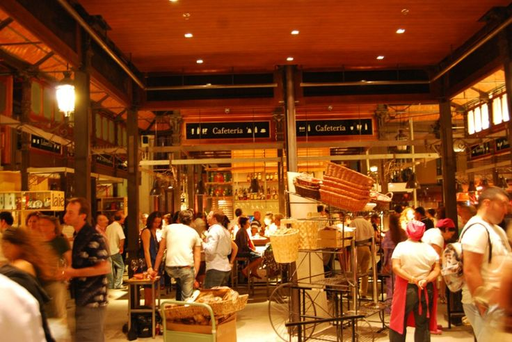 The new concept of San Miguel market in Madrid, Spain, opened its doors May 16 2009, with immediate and smashing success. The old cast-iron pillars now support one of Madrid's hot spots for shopping, food and drinks, and diverse cultural events.