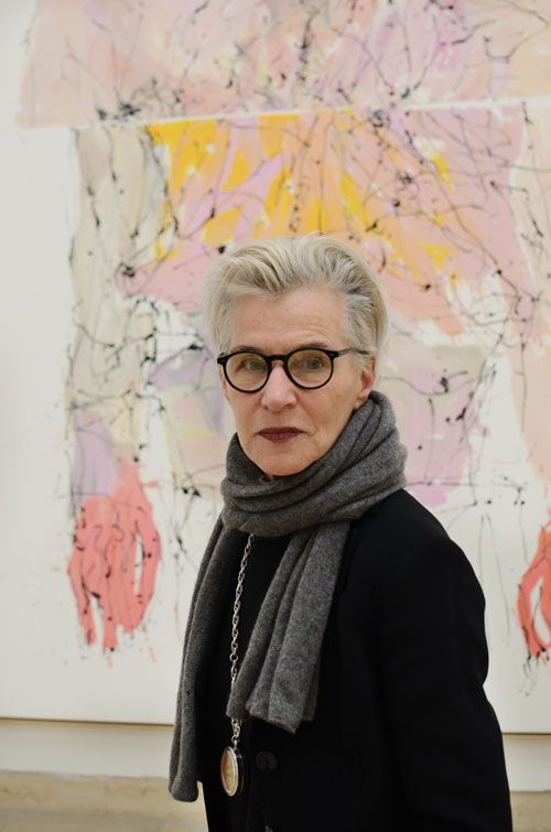 Brigitta's short silver hair in front of Georg Baselitz