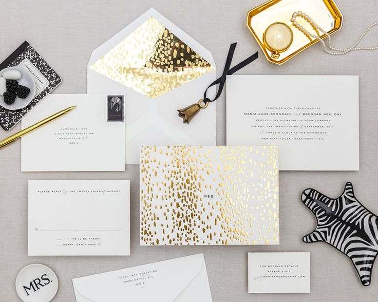 Golden Divinity. Bold and gold! This invitation has two sides and there's a hint of animal print. Bring in the mirror paper envelope liner to add even more glam to this set. Cheree Berry Paper