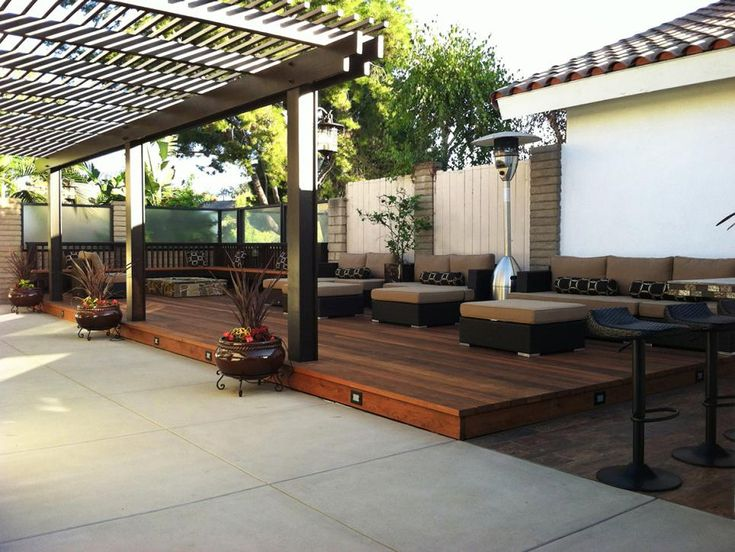 the large pergola allows for plenty of shade in this outdoor space while the lounge
