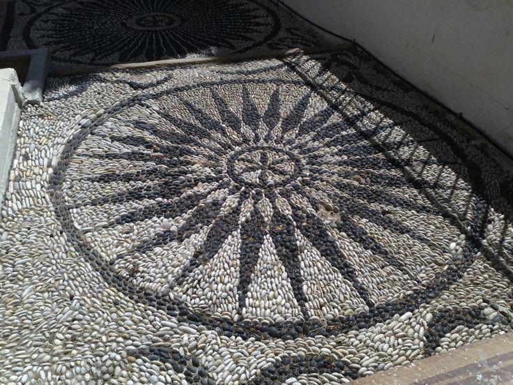 Mosaic floor at Chios Island, Greece. Photo: http://maryeliopoulou.wordpress.com/2012/12/11/βοτσαλοτο/