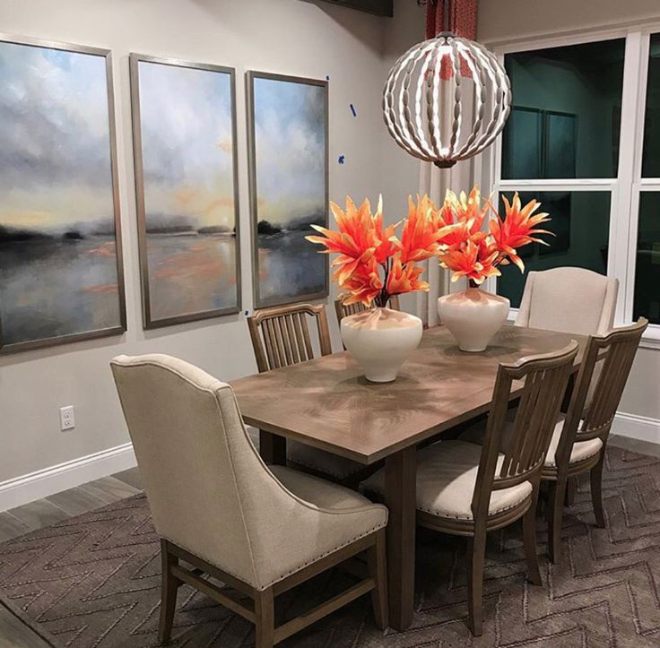 A neutral dining room with a pop of color uses Surya's Mateo rug as a foundation. (MAE-1005)