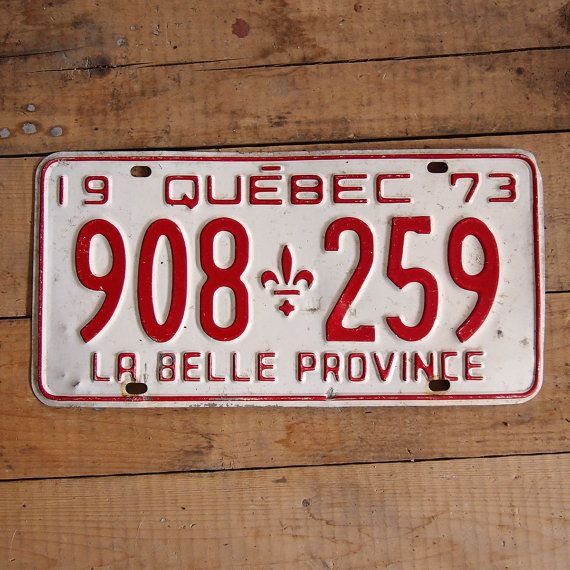 Vintage license plate  Quebec from 1973  red and by Auboutdurang