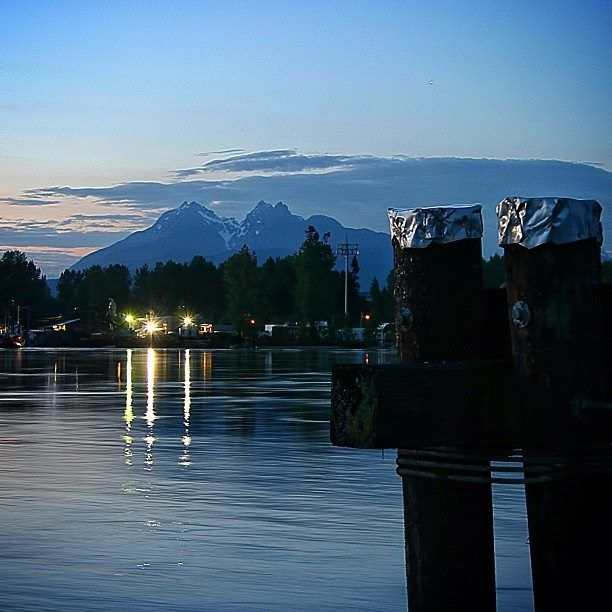 """Twilight over Twin Peaks (McPhaden & Edge Peak), looking over the Fraser River at Albion, Maple Ridge from the Government Dock on Brae Island."" Submitted by @seaside_signs via Instagram."