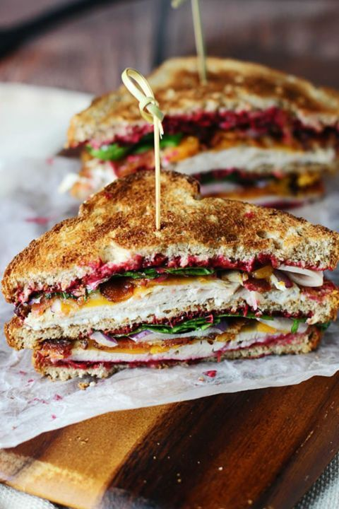 The Ultimate Leftover Turkey Club: The name of this sandwich says it all! This is the ultimate turkey sandwich that is filled with yummy Thanksgiving leftovers like carved turkey and cranberry sauce. Find more easy and healthy turkey sandwich recipe ideas made from Thanksgiving leftovers here.