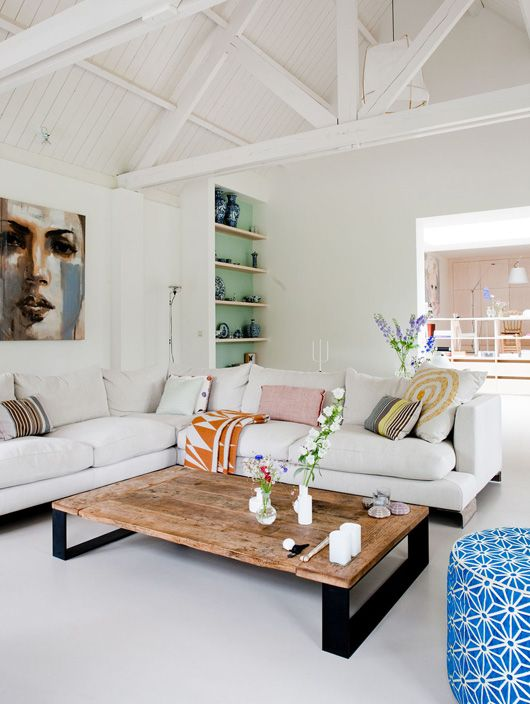 vaulted ceilings, comfy sectional, large scale art, hints of happy color...totally livable