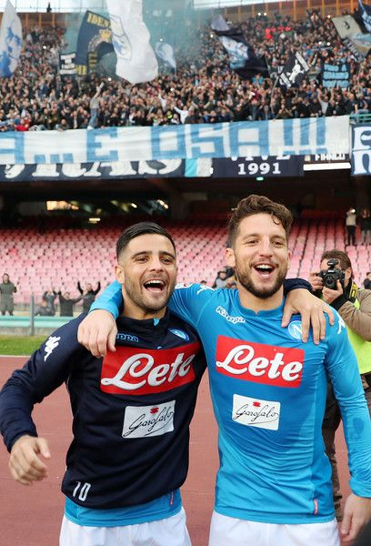 Players of SSC Napoli Lorenzo Insigne and Dries Mertens celebrate the victory after the serie A match between SSC Napoli and Bologna FC at Stadio San Paolo on January 28, 2018 in Naples, Italy.