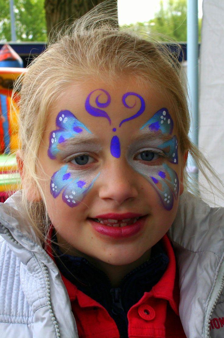 Beautiful blue butterfly face paint design