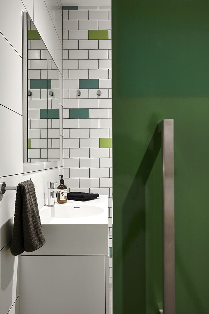Over sized Sliding door in Dulux 'Tarmac Green' entry to the bathroom at Herbert Street Northcote