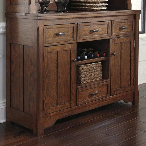 Signature Design By Ashley Chimerin Burnished Oak Dining Room Buffet