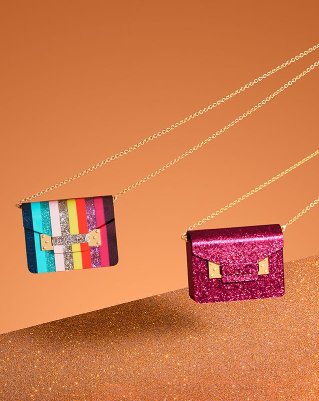Are you ready for party season? Our Compton envelope clutch is a statement addition to your look - choose Rainbow or our exclusive Fuchsia Glitter colour way, available only at sophiehulme.com
