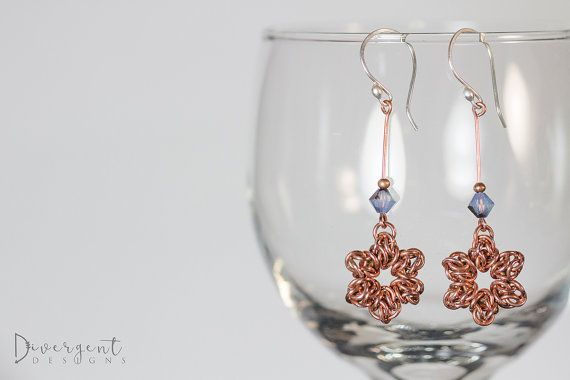 """(Autumn is my favourite season)  Copper rings, handwoven into stars and adorned with swarovski crystals.  Length: 5.5cm/2.16""""  ** All my ear wires are made of sterling silver and are nickel free."""