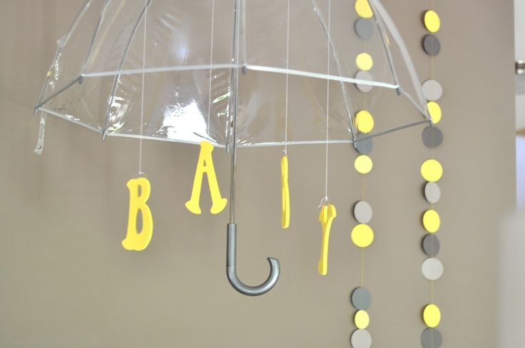 We love the use of umbrellas as baby shower decor! #babyshower
