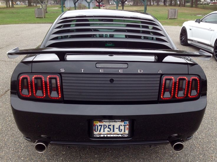 Black 2007 Ford Steeda Mustang Gt With Silver Horse Racing Rear Quarter Window Louvers Mrt Rear Louvers Axis Sport Wheels Coches Personalizados Mustang Autos