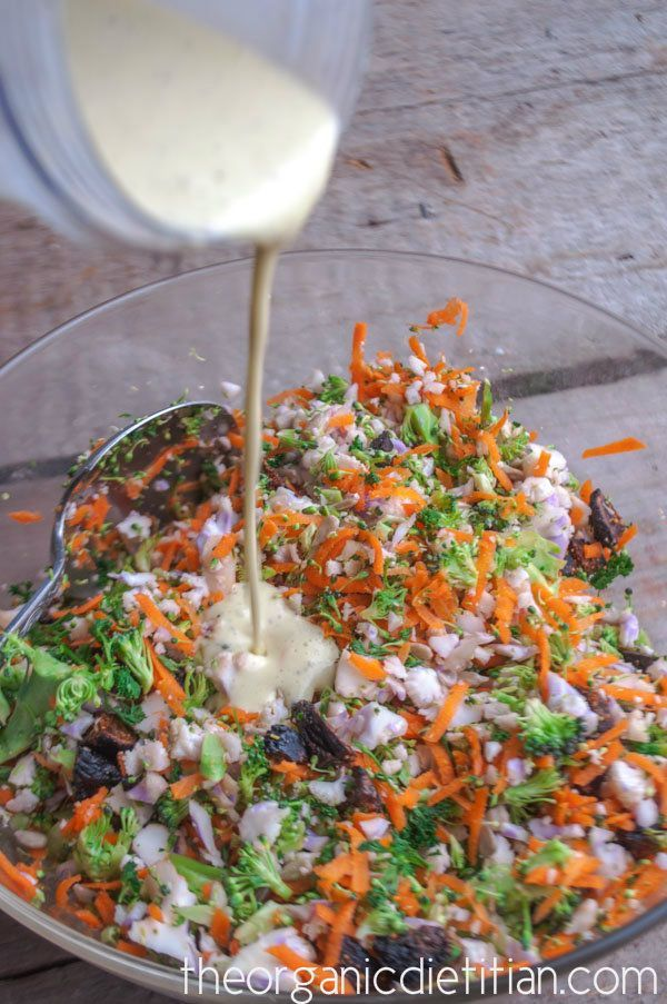 The Cruciferous Veggie: Cauliflower Broccoli Salad with raisins, carrots, sunflower seeds in a lemon vinaigrette. Raw, vegan, paleo - The Organic Dietitian