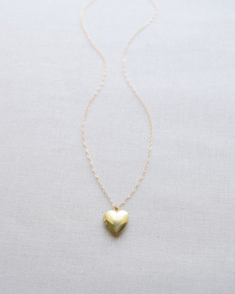 Heart Locket Necklace - Petite brass heart locket charm on a gold chain. A beautiful gift for a loved one. By Olive Yew.