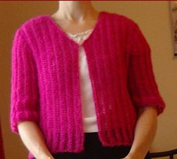 Knitting pattern for a ladies lacy rib jacket with elbow length sleeves.