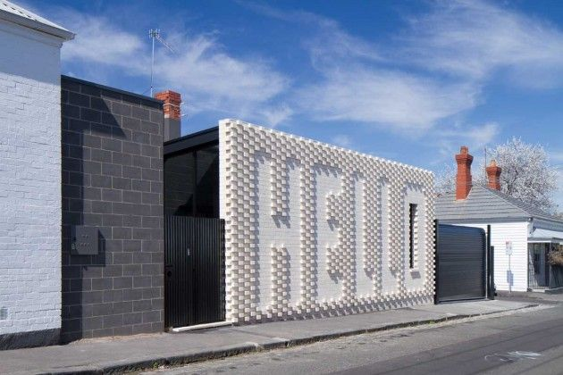 Hello House by OOF! Architecture OOF! Architecture worked together with artist Rose Nolan, to create the Hello House, which features an exterior brick wall of the artists work. The house is located in Richmond, a suburb of Melbourne, Australia