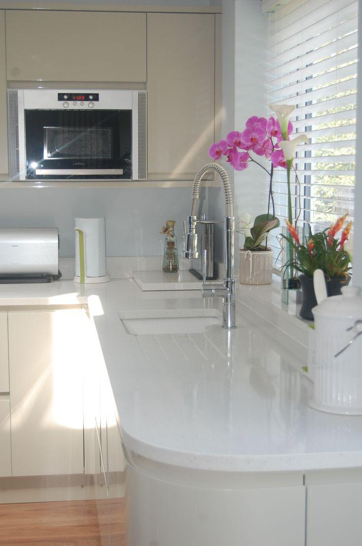 Compac Moon White Quartz Worktops with cream kitchen cabinets. Installed in Bromley, Kent.